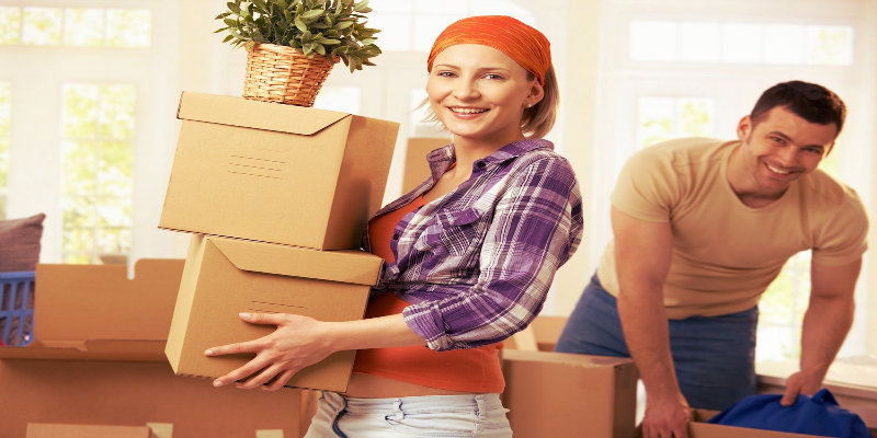 a guy packing delicate items
