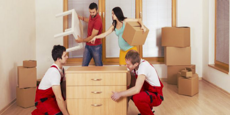 2 removalists and a couple preparing for a move