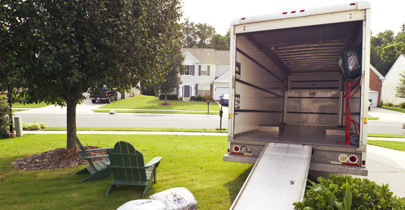 An empty truck outside a property getting ready for loading